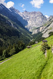 View through Alps valley near Gletch with Furka pass mountain ro Royalty Free Stock Photo