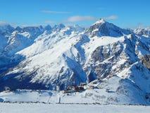 The view from the altitue 3200 metres. Dombay - a downhill skiing resort in Karachayevo-Cherkesiya, Russia.. Tourists in Dombay - a downhill skiing resort in Stock Images