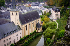 View of Alzette, Luxembourg. A view over the lower city of Luxembourg from the ramparts of the fortress of the old city area. An old church by the Alzette river royalty free stock photo
