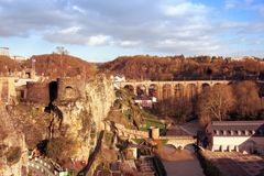 Alzette River and fortress remains in Luxembourg. A view of the Alzette River as it passes through the Grund Quarter in Luxembourg City, Luxembourg, highlighting Royalty Free Stock Photo