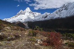 View of Ama Dablam from Pangboche. PANGBOCHE, NEPAL - CIRCA OCTOBER 2013: view of Ama Dablam from Pangboche circa October 2013 in Pangboche Stock Photo