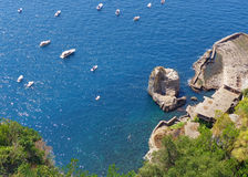 View of Amalfi Coast, Italy. High angle view of boats in blue sea and rocky coast Stock Photo