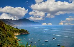 The view of Amalfi coast. This is on the south of Italy in Europe. The city stands on cliffs above the sea. There are boats on the stock image