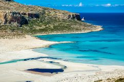 View of the amazing beach of Balos, with a family playing on the tropical sandy beach with turquoise waters Royalty Free Stock Photography