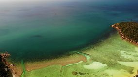 View of amazing coral reefs. Picturesque drone view of tranquil blue sea and beautiful coral reefs near coast of stock footage