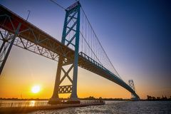 View of Ambassador Bridge connecting Windsor, Ontario to Detroit. Michigan at sunset time Royalty Free Stock Photos