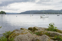 View from Ambleside lake shore of boats and sea-gulls. View from lake shore of boats and sea-gulls in Ambleside , Lake Windermere in the UK Royalty Free Stock Photo