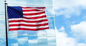 View of American flag on blue building background Royalty Free Stock Image