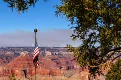 American flag with scenery at the Grand Canyon in the background Royalty Free Stock Photos