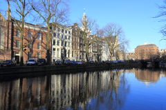 View of Amsterdam canal, typical dutch houses and boats, Holland, Netherlands. Stock Photo