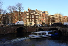 View of Amsterdam canal, typical dutch houses and boats, Holland, Netherlands. Royalty Free Stock Photo