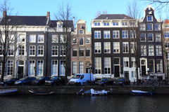 View of Amsterdam canal, typical dutch houses and boats, Holland, Netherlands. Stock Images