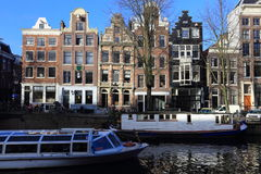 View of Amsterdam canal, typical dutch houses and boats, Holland, Netherlands. Royalty Free Stock Photos