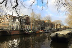 View of Amsterdam canal, typical dutch houses and boats, Holland, Netherlands. Royalty Free Stock Image