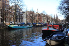 View of Amsterdam canal, typical dutch houses and boats, Holland, Netherlands. Stock Photography