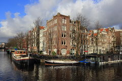 View of Amsterdam canal, typical dutch houses and boats, Holland, Netherlands Royalty Free Stock Image