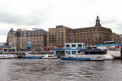 View of Amsterdam from Central train station building with a canal Stock Images