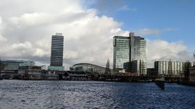 View of the Amsterdam Harbor. A view of the Amsterdam harbor with the library and museums stock photo
