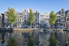 View of Amsterdamse merchant houses on the canal Stock Images