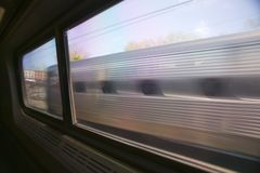 View of Amtrak train car from another moving Amtrak train, Philadelphia, Pennsylvania Stock Photos