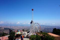 View of an amusement park and to Barcelona, opening from the height of the hill of Tibidabo. royalty free stock photo