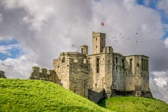 A view an ancient castle on a green hill. stock images