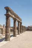 View of the ancient columns in Pompeii ruins. Forum columns in the ancient Roman city Pompeii near modern Naples in the Italian region of Campania stock photography