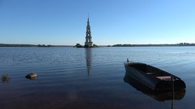 A view of an ancient flooded bell tower. July evening. Kalyazin, Russia stock footage