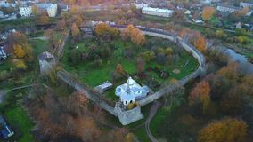 View on the ancient fortress of the city of Porkhov, October evening. Pskov region, Russia aerial video stock video