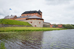 A view of the ancient fortress-jail Hameenlinna by Vanajavesi lake Royalty Free Stock Photo