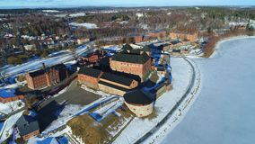 View of the ancient fortress-prison of Hameenlinna, March day aerial video stock footage