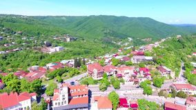 View from the ancient fortress at Sighnaghi, Georgia. A view from above of the landscape of the city and mountains. The. Clouds float above the mountains stock video footage