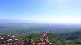 View from the ancient fortress at Sighnaghi, Georgia. A view from above of the landscape of the city and mountains. The. Clouds float above the mountains stock video