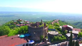 View from the ancient fortress at Sighnaghi, Georgia. A view from above of the landscape of the city and mountains. The. Clouds float above the mountains stock footage