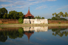 View of ancient gate and bastion of the Old city in the solar evening. Mandalay, Myanmar Stock Image