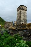 View of ancient georgian village with fortified towers,Svaneti. View of ancient Murqmeli village with fortified towers in overcast weather,settlement Ushguli royalty free stock photos