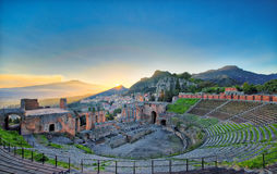 View of the ancient greek theater of Taormina with Etna volcano stock image