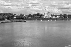 Monochrome view of the Monastery of St.Catherine on the Volga river from the opposite pedestrian embankment. City of Tver, Russia. royalty free stock photo
