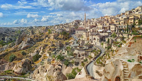 View of ancient Nevsehir cave town and a castle of Uchisar royalty free stock image