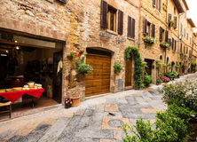 View of the ancient old european street in Pienza. Italy. Stock Photos