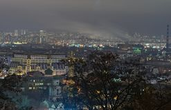 View of the ancient Podil district and modern Obolon district at background. Evening city panorama. Winter weekend evening. Kyiv. Ukraine Stock Photography