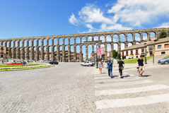 View of ancient roman Aqueduct of Segovia. SEGOVIA, SPAIN - JULY 10, 2011: view of ancient roman Aqueduct of Segovia on Plaza del Azoguejo. It consists of about royalty free stock photos