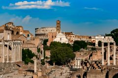 Forum Romanum and Colosseum. View of the ancient Roman ruins at Forum Romanum with Colosseum in background Royalty Free Stock Photography
