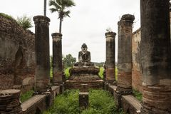 Ruins of an old Burmese temple. View of the ancient ruins of an old Burmese stone temple. In the ancient city of Inwa, Myanmar royalty free stock images