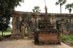 Ruins of an old Burmese temple. View of the ancient ruins of an old Burmese stone temple. In the ancient city of Inwa, Myanmar stock photos