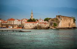View of ancient seaside town with high stone walls Royalty Free Stock Images