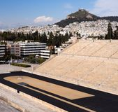 View of the ancient stadium of the first Olympic Games in white marble - Panathenaic Stadium - overlooking the Lycabettus hill. View of the ancient stadium of stock image