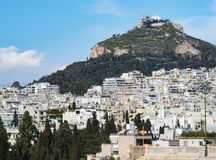 View of the ancient stadium of the first Olympic Games in white marble - Panathenaic Stadium - overlooking the Lycabettus hill. View of the ancient stadium of royalty free stock image