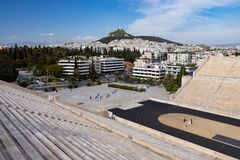 View of the ancient stadium of the first Olympic Games in white marble - Panathenaic Stadium - overlooking the Lycabettus hill. View of the ancient stadium of royalty free stock photo
