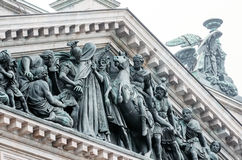 View of the ancient statues of stucco and the dome of St. Isaac`s Cathedral Petersburg Stock Photography